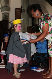 Receiving their learning journeys, pictures and graduation scrolls!